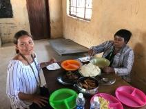 Isabel and Harriet eating Nshima goat stew at Kalalasaka